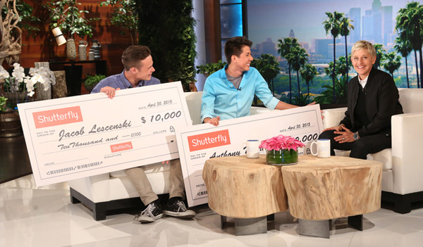 ellen gives check to prom guys